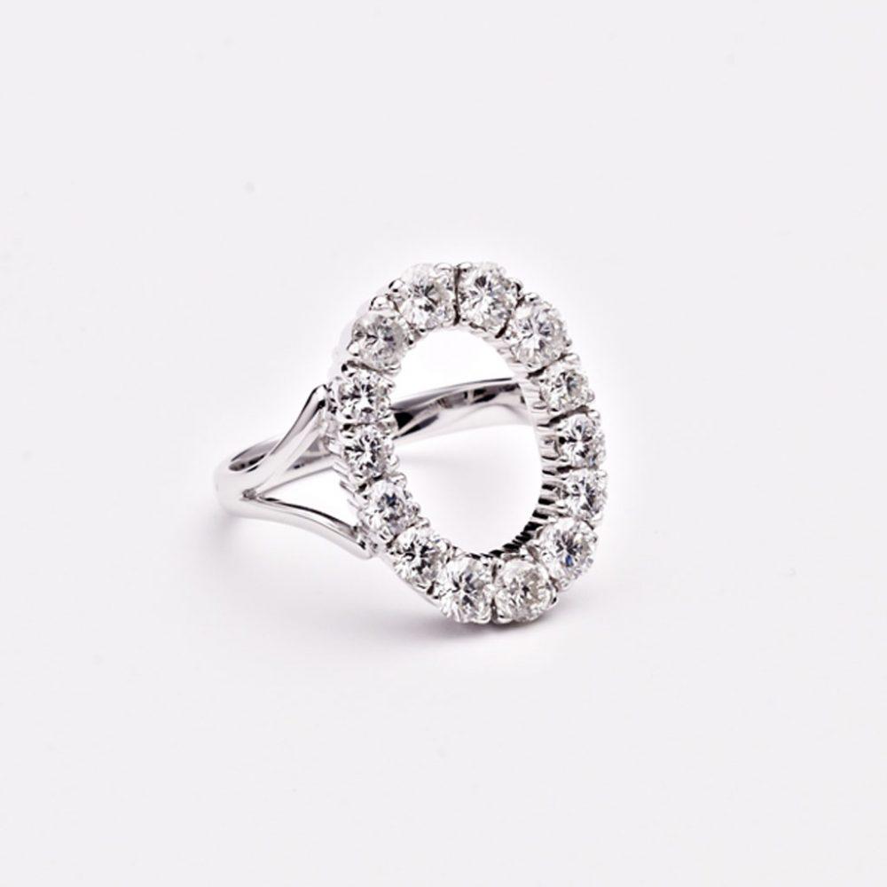 Handmade open oval 9ct white gold and diamond engagement ring made from inherited diamonds heritage repurposing.