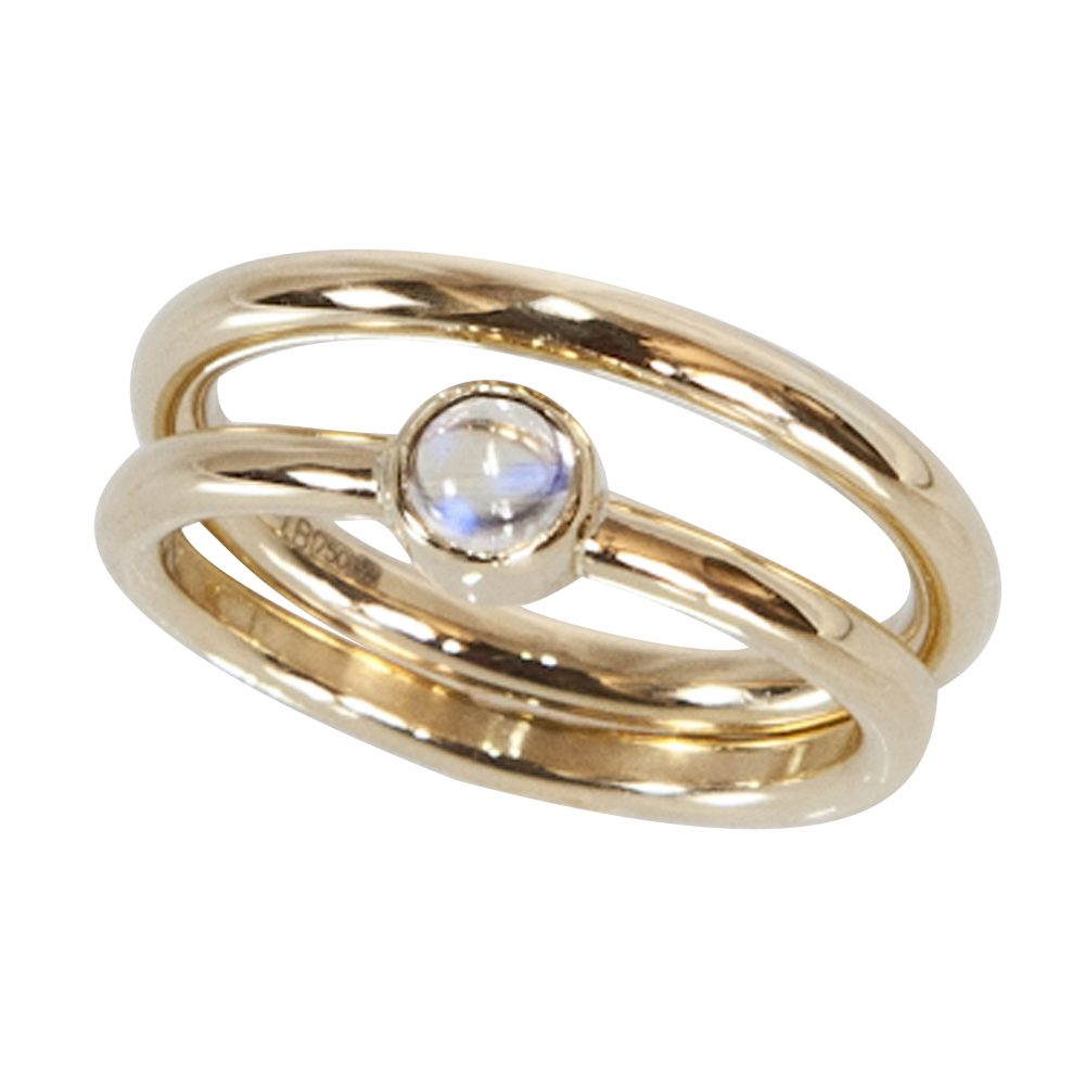 Contemporary clean lines define this bezel set moonstone wedding and engagement ring, hand made in 18ct yellow gold.