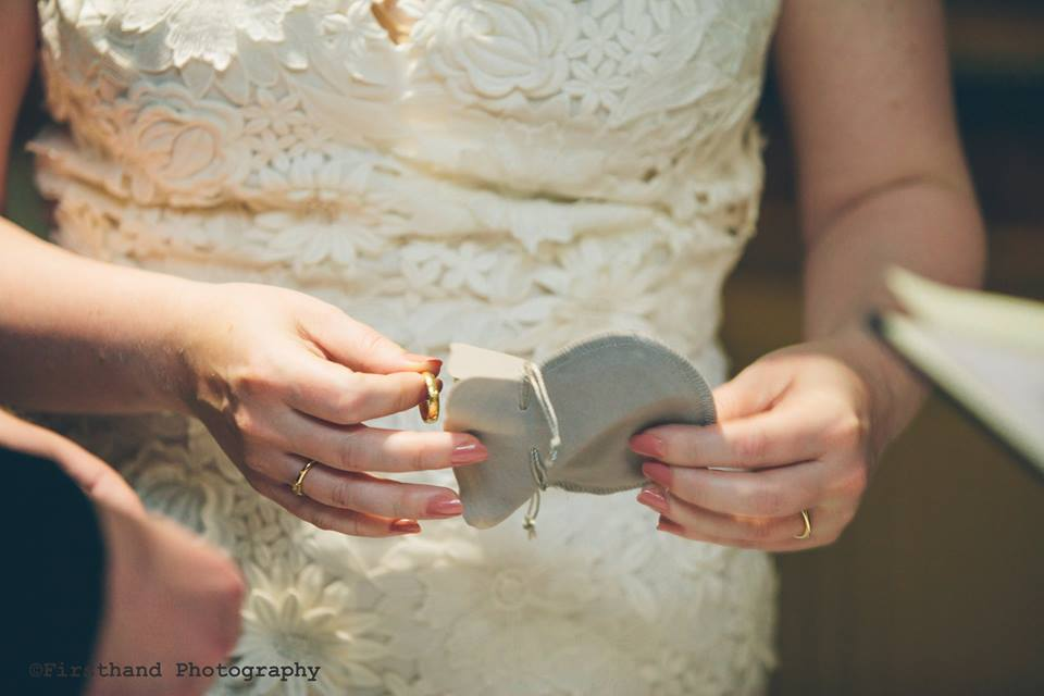 Bride and groom photo of ring exchange at wedding ceremony