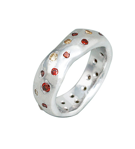 Organic shaped wedding ring with scattered mixed colour diamonds bead set randomly around the whole ring.