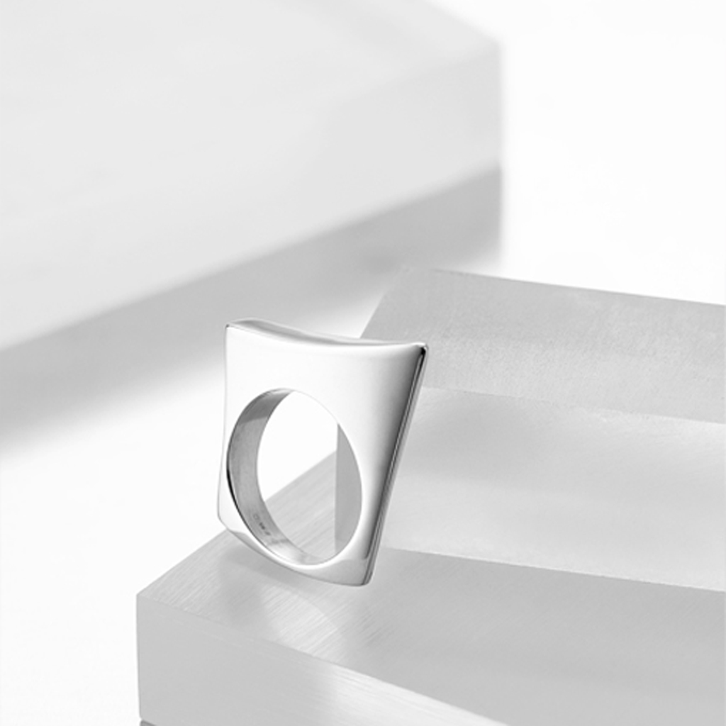 Solid sterling Silver contemporary style ring resembling a sail board on the sea.