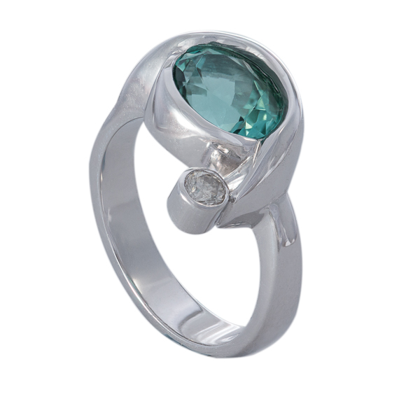 Wave ring made with sea green tourmaline and diamond handmade from 18ct white gold